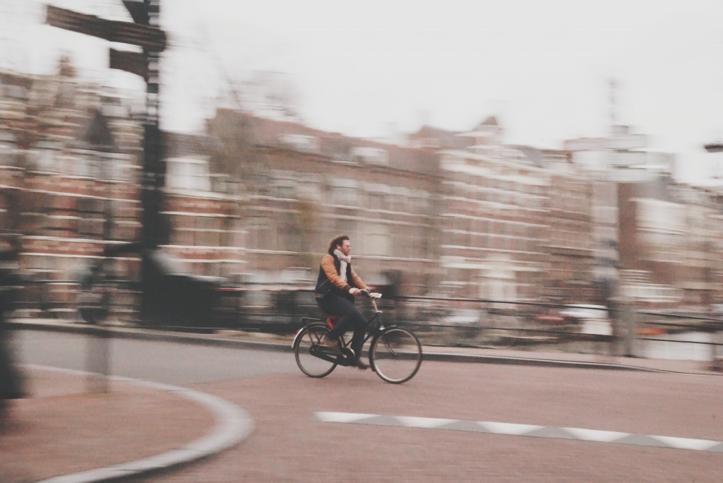 Júnia Neumann cycling photo through Amsterdam commuter heaven