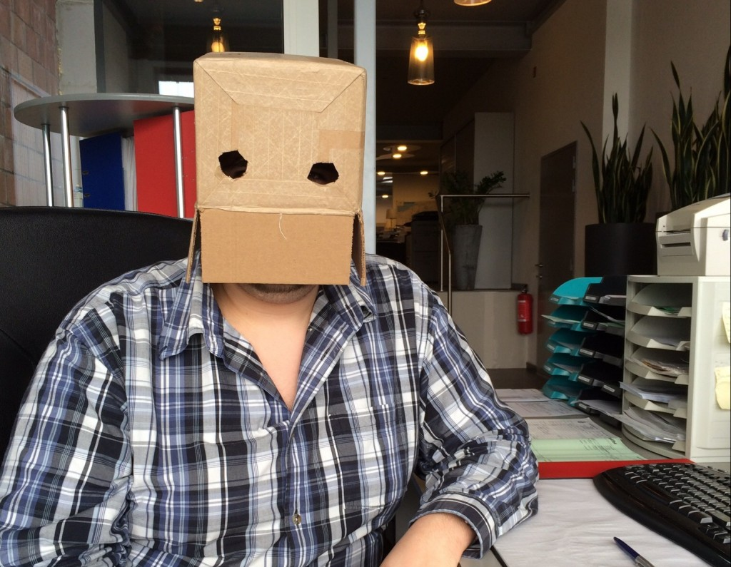 Man in office with a box on his head - office joke