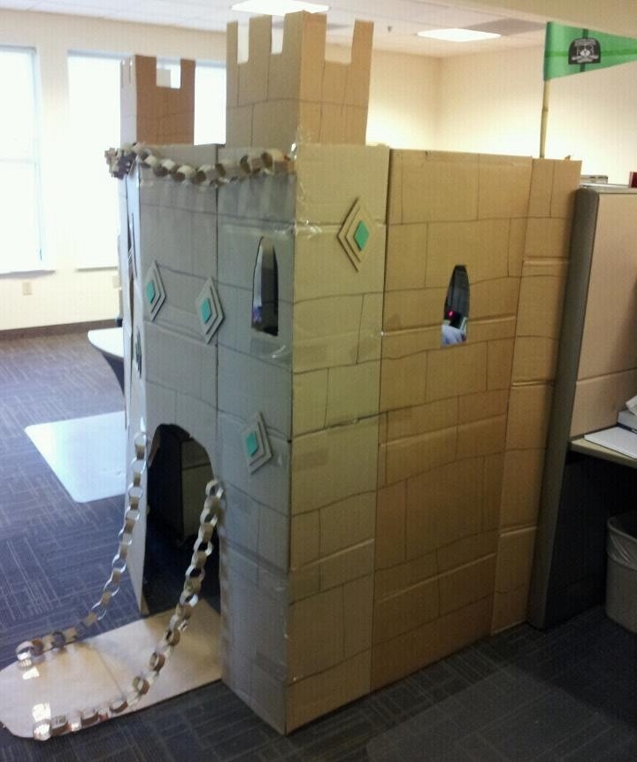 Office war with a castle made of cardboard
