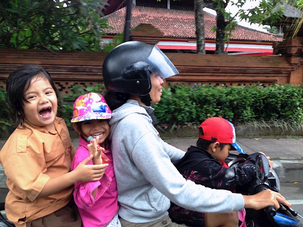 Omar Velazquez photo of people on a bike - Scoopshot